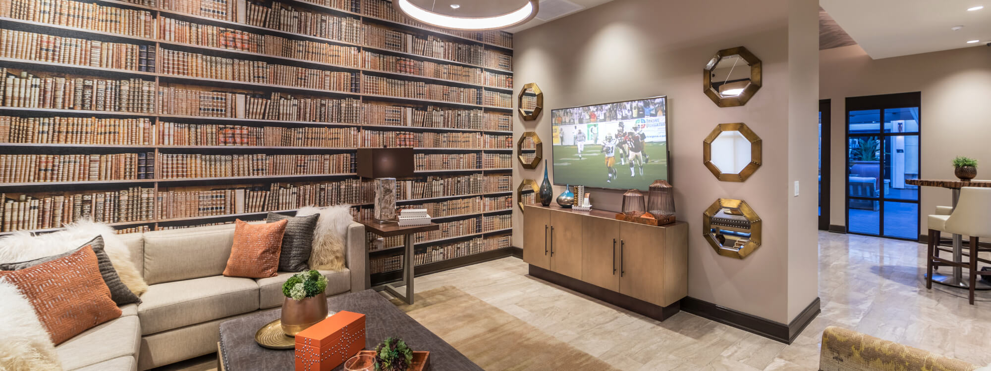 Club Room with Media and Custom Bookcase Wall Graphic